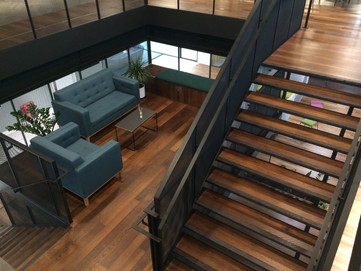 (3) Mid city Place feature staircase with mezzanine meeting room
