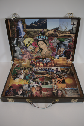 """Virginia Garcia """"Healing Without Borders"""" 17"""" x 11.5"""" attaché case collage  I used an attaché case 17 x 11.5. I used glue, magazines, and mod podge. I have been a sobadora (massage therapist) for 28 years. I have learned about herbs and natural healing touch, an example is how an egg is used for empache (a blockage, and rosemary romero for cleansing).  I have attended the """"healing without borders"""" with the curanderas for about 16 years at the University of New Mexico. The many things I have learned are portrayed in this collage. My medicine is all in this art form, music, dancing, walking, hiking, love, friends, and prayer and that is why this work is holy. The greatest of this work is """"love"""" because it comes from the heart and it heals emotionally, physically, and spiritually. The healer prays to the four (4) directions and asks their divine """"higher power"""" for help.  """"The Sunflower"""" Sunflower, the flower of the EAST, facing the sun, opening the day to a glorious beginning. I always accept and love what you offer me today to  begin with prayer, praise, and meditation for today.  To the direction of the WEST, where wild flowers and grass grows. I let go of all that does not serve me.  Forgiveness, acceptance of what is, letting go with the  pain of detachment.  To the direction of the NORTH, where our ancestors are, with their advice and example to carry on in late winter  when the cocous bloom. My prayer is to heed their knowledge for strength. To the direction of the SOUTH, where roses are in full bloom. With the children playing and accepting life just  as it is.  ARTIST STATEMENT My name is Virginia May Garcia. I have been doing """"collage"""" for 20 years."""