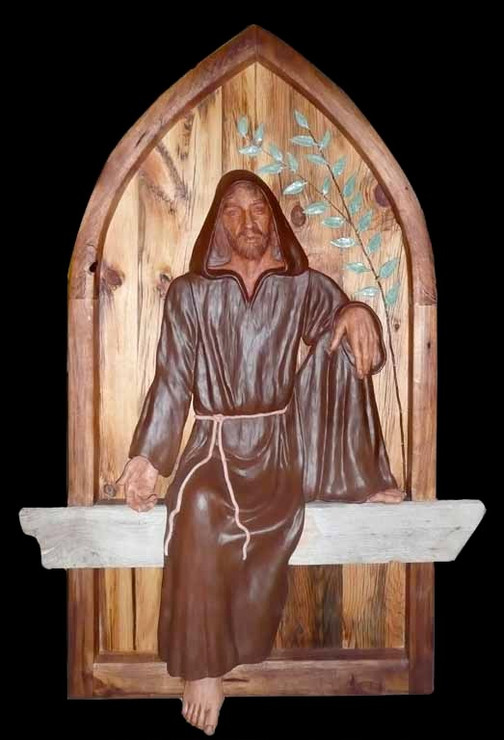 """Alison Aragon  """"St. Francis"""" 5.5' x 4'   This piece was originally commissioned by the Franciscan Sisters of Chicago. The Franciscan Sisters wanted a bas-relief for their Peace Chapel which was at The Clare in downtown Chicago. They wanted an image of St. Francis where his expression was of peace and comfort. The backboard it is mounted on is weathered barn wood. The figure of St. Francis is cast in cement and textured with Bondo. The leaves represent olive leaves and are of ceramic clay with fired glaze. Parts of the figure are painted acrylic. The wood is sealed with polyurethane. It is a life-sized figure mounted on wood about five and a half ft. tall by about four ft.   ARTIST STATEMENT I consider myself a Liturgical Artist and Portraitist. Bringing a contemporary interpretation to subjects of faith is of primary interest to me. I love to work with communities to develop art for their spaces, bringing a tailored vision to sacred spaces. The bronze statue of Mary Magdalene in the Norbertine Community's Santa Maria de la Vid Abbey Church is one of my pieces. I do all my own sculpture work, I do not sub-contract it. This means my clients have the hand of the artist they hired on the project.   *While this art piece is not physically present at Santa Maria de la Vid Abbey, visit the Church of Santa Maria de la Vid to see the bronze statue of Mary Magdalene by the artist."""