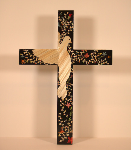 """Lenise Lujan-Martinez """"Espiritu Santo"""" 16.5"""" x 11.25"""" x 0.25"""" cross, pine, black paint, natural & dyed wheat straw, wood glue, spray finish  Holy Spirit with wings wrapped around the cross placed on """"The Tree of Life.""""  I was inspired to create this piece from the great works and my love of the Holy Spirit. The Tree of Life is a popular & universal symbol that represents many different things across various  cultures & religions. It symbolizes togetherness and serves as a reminder that we are never alone or isolated, we are connected to the world.   ARTIST STATEMENT My birth place and home is Santa Fe, NM. I have been married for 31 years to my husband, David Martinez. We have two beautiful, adult children, Alexandria, age 28, and Isaiah, age 23. My mother, Diane Moya-Lujan, whom is also a Straw Appliqué Artist, taught me this beautiful art form. I juried into the Spanish Market in 2000.  My upbringing & privilege of being born in Santa Fe taught me a wonderful understanding of my Hispanic culture and traditions. The art of Straw Appliqué has become my passion."""