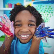 Happy kid enjoying arts and crafts painting with his hands.jpg