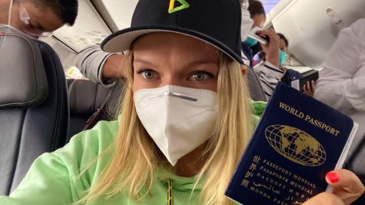 Katie Ananina holding a passport