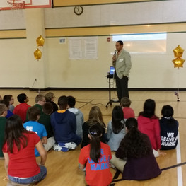 Quentin speaks to elementary students at Sablatura