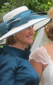 White and teal sinamay hat