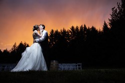 Romantic sunset wedding kiss