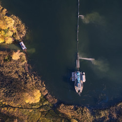 Aerial View Of Dredge Mining Gold and Diamonds in River