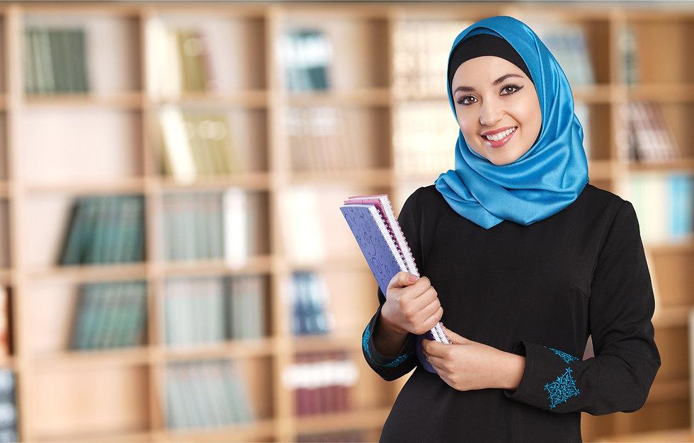 Muslim woman with notebooks.jpg