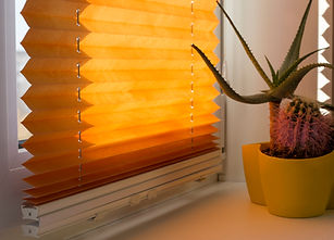 Pleated blinds with orange folded fabric