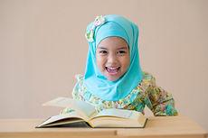 Happy Muslim kid during Quran during ram