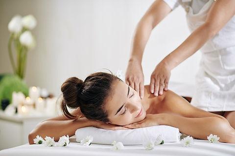 woman-getting-back-massage_274689-13210.
