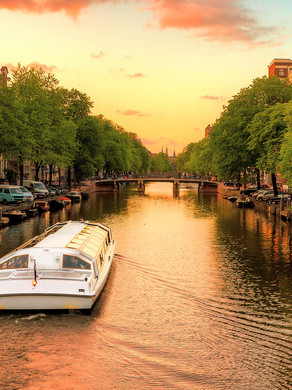 Sunset cheese and wine tasting on a boat cruise of Amsterdam's canals