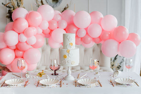 Birthday or wedding table setting in white colors with cocktails in glasses. Baby shower o