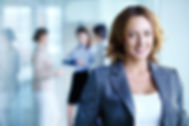 Image of pretty businesswoman looking at