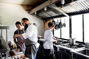 group-chefs-working-kitchen_53876-42734.