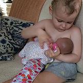 Cecille nursing her baby on her  nickles
