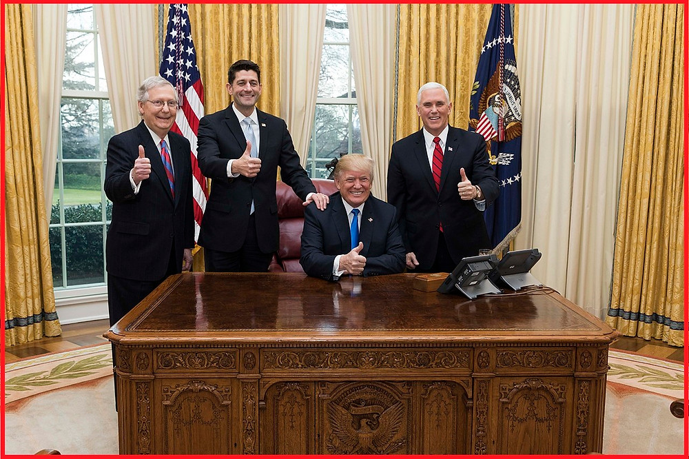 L-R Sen. Maj. Leader Mitch McConnell, Speaker Paul Ryan, President Donald Trump, Vice President Mike Pence celebrate passage of the Tax Cut and Jobs Act on Dec. 20, 2017.  White House Photo.
