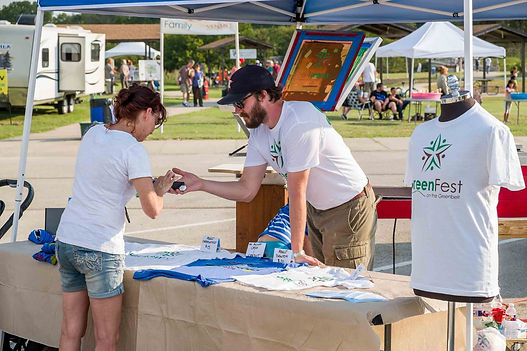 GreenFest volunteer handles ticket and merchandise sales