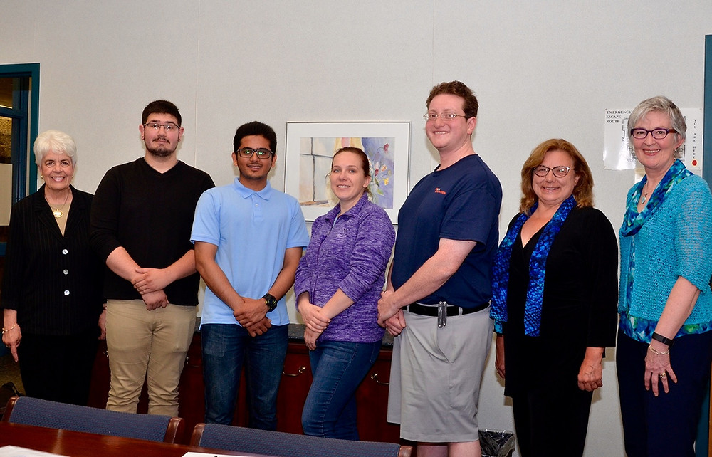 L to R: Tunxis President Cathryn L. Addy; Jesse Gutaukas; Dhrumil Shah; Elena Bolotova; Matthew Stromberg; Tunxis Professor Karen Wosczyna-Birch, who heads the initiative's leadership team; and Dr. Nancy Ruther, President, Gazelle International.