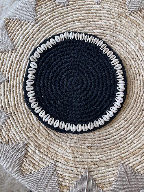 Black placemat white shells
