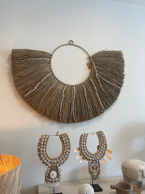 straw wall decoration with shells
