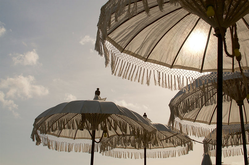 bohemian umbrella on the beach of marbella Me Ka Homes