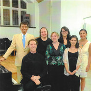 Composer Adams with performers at an All Adams Music Concert