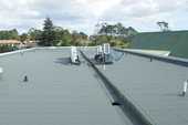 Torch on flat roof with gutter