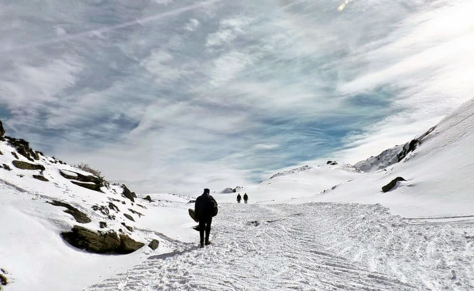 Trek in snow-capped mountains