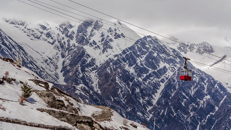 cable car ride on snowy mountains