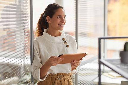 successful-female-entrepreneur-smiling-HPVGMCQ.jpg