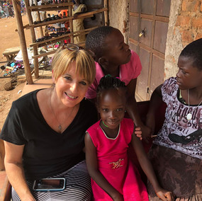 Gina Cox with Ugandan Children.jpg
