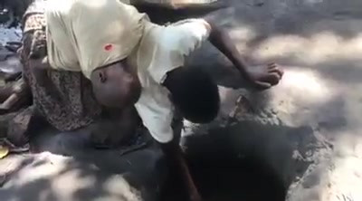Young Woman Digging for Water in Uganda