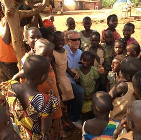 Jay Cox with Children in Uganda.jpg
