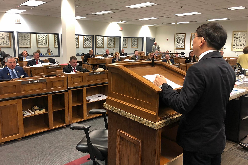 Mr. Chester Chu, manager of the State of Wyoming - Asia Pacific Trade Office, presenting at the legislature.