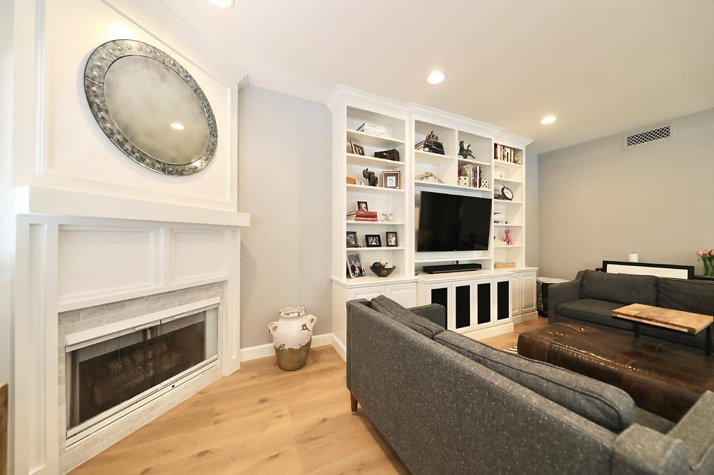 Custom white Built-In Media Center & Storage in a living room