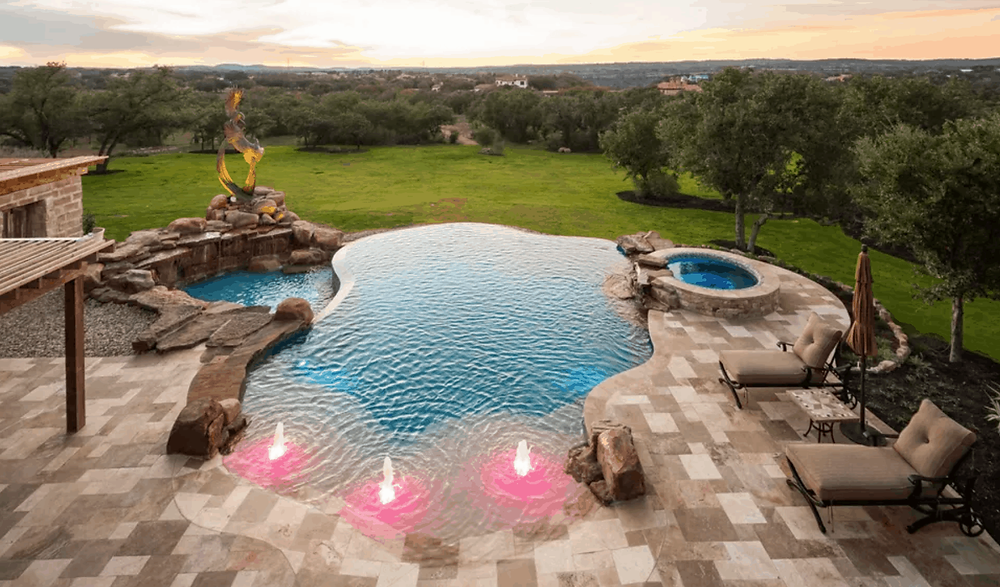 A Backyard Infinity Pool with Water Features, Hot Tub and Mood Lighting