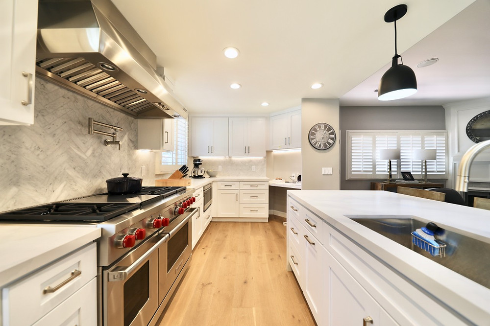 contemporary open concept white kitchen and living room combination