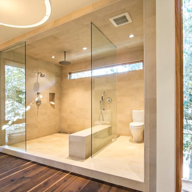 A Shower Ceiling with Tile, Rain Shower and Recessed Lighting