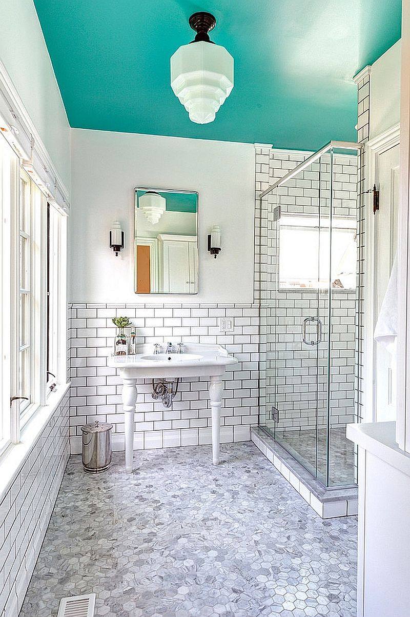 a white and marble bathroom with a teal painted ceiling