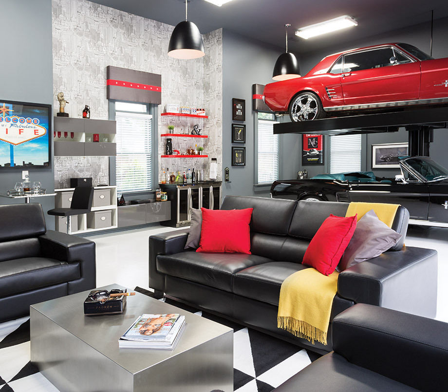 a garage remodel with a car lift and living room