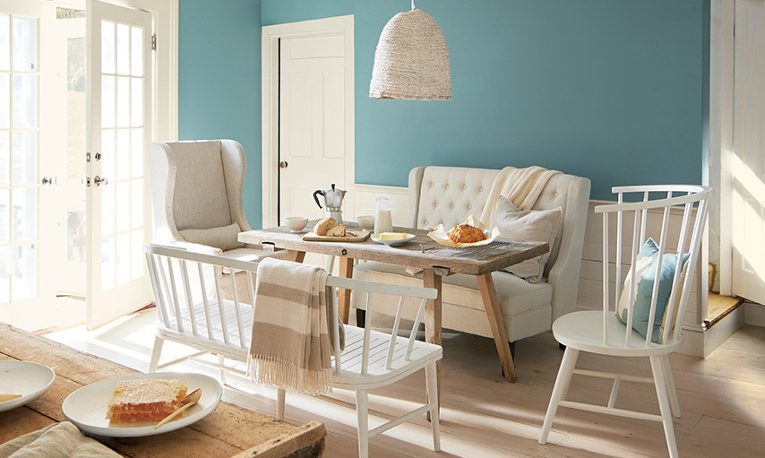 breakfast nook with an aegean teal accent wall