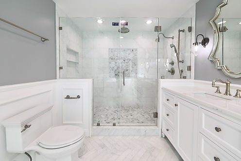 large white marble master bathroom with an extra large shower and double vanity