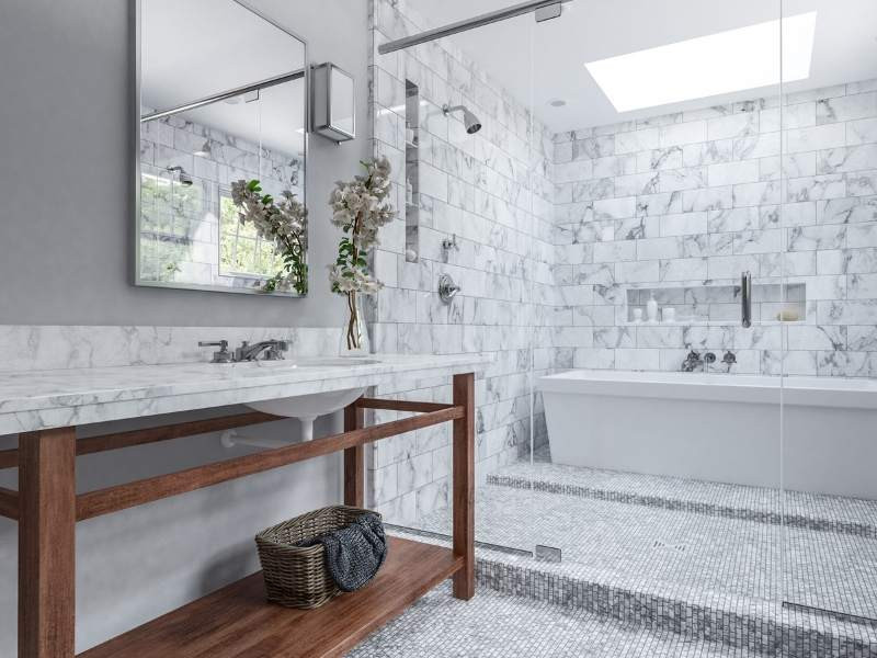 a marble bathroom with a large wet room with a shower and freestanding tub