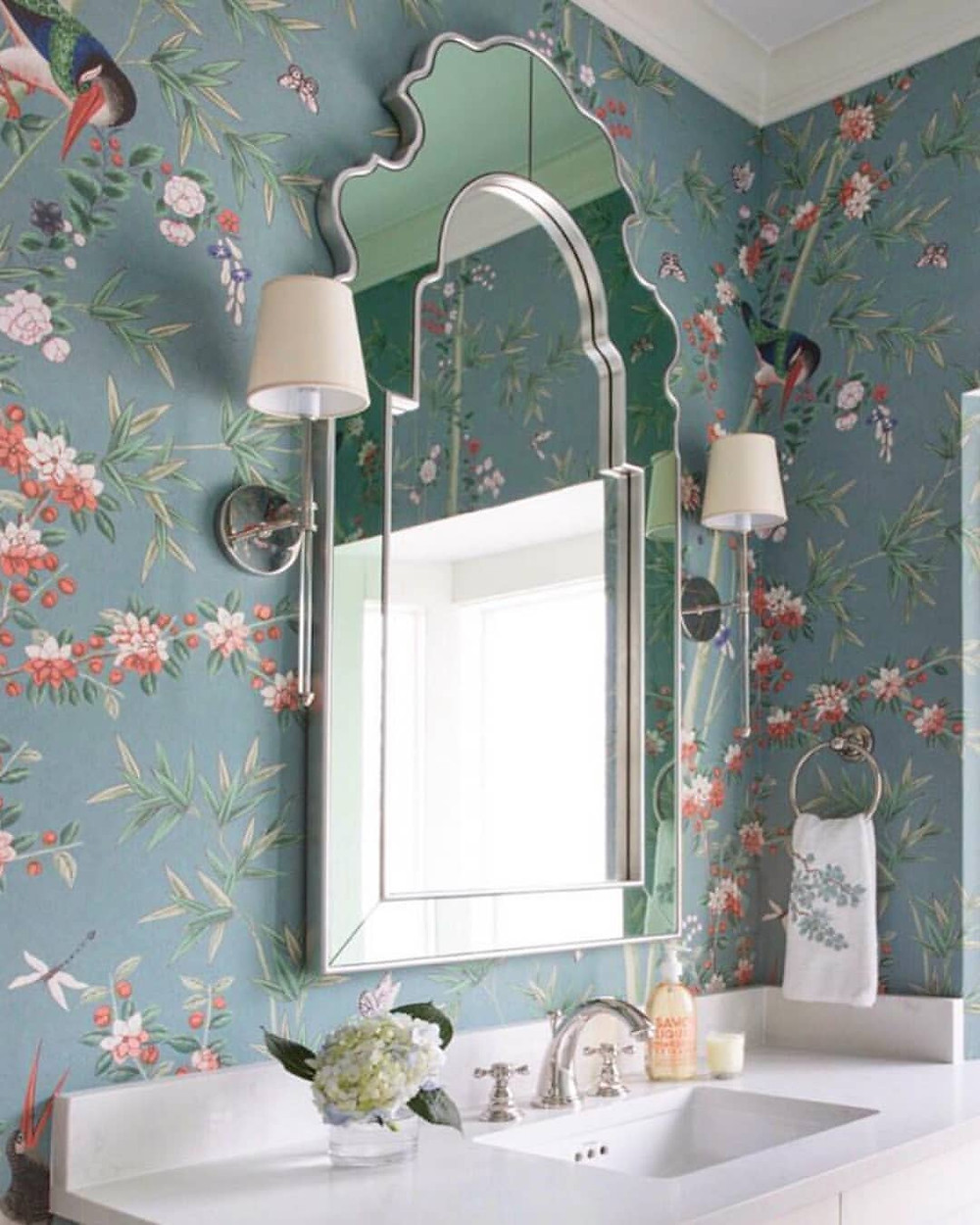blue floral and bird wallpaper by schumacher in a bathroom