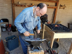 Master Blacksmith at the Anvil