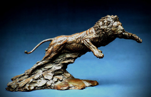 Lion Charging. Height 29cm x 53