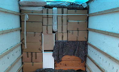 packed boxes on a van