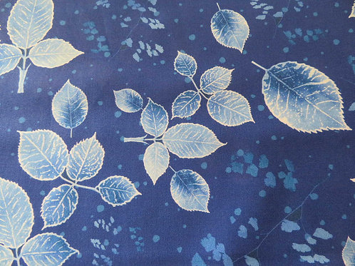 Silver and blue leaves on blue background