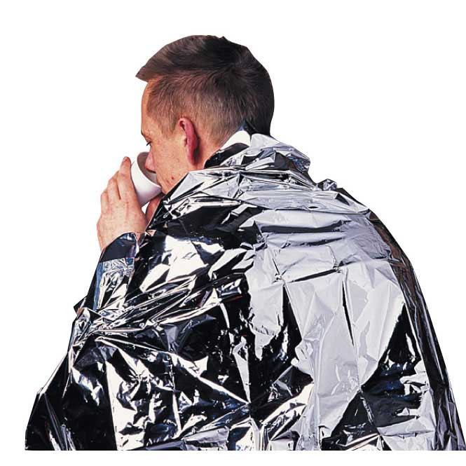 An image of a man wrapped in a foil blanket, drinking from a disposable cup