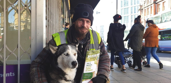 A portrait of a Big Issue North Vendor and his dog